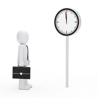 Trabajador ocupado al lado de un reloj