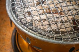 Vaciar barbacoa caliente.