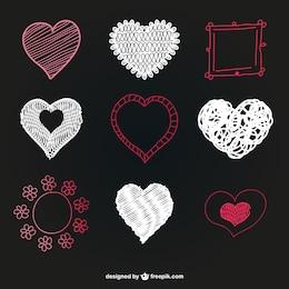 Vectores de corazón en pizarra