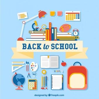 Volver a la escuela letras con muchos suministros