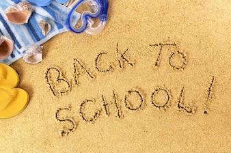 vuelta al colegio  escrito en la playa
