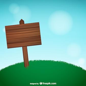 Cartel de madera sobre la hierba
