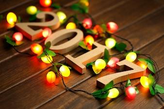 2017 Felice Anno Nuovo, figure di legno e luci lampeggianti sul retro desktop