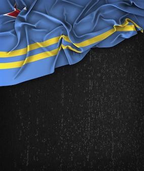 Aruba Flag Vintage su una lavagna nera Grunge con spazio per il testo