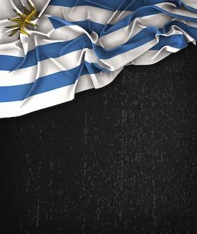 Bandiera dell'Uruguay Flag su una lavagna nera Grunge con spazio per il testo