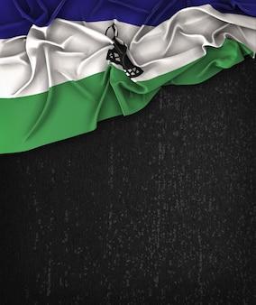 Bandiera Lesotho Vintage su una lavagna nera Grunge con spazio per il testo