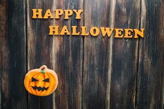Buon compleanno di Halloween e biscotto jack-o-lantern
