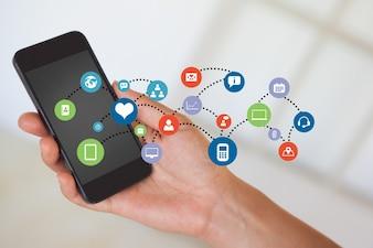 Close-up del telefono cellulare con una nuvola di applicazioni