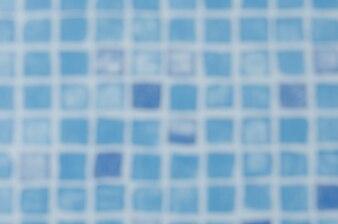 Distorsione sfocata di piastrelle in piscina