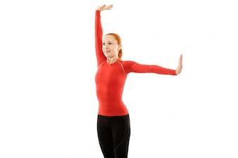 Donna rossa facendo fitness