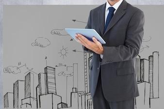L'uomo in tuta con una tavoletta e lo sfondo di una città disegnata