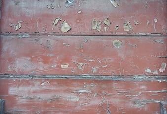 Parete di legno con vernice rossa