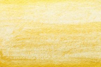 Pittura ad acquerello astratta in oro giallo su sfondo bianco di carta