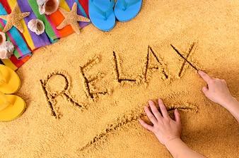 Rilassatevi la spiaggia di scrittura