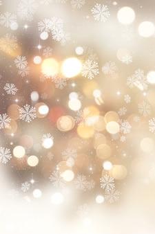 Sfondo dorato di Natale con i fiocchi di neve e stelle