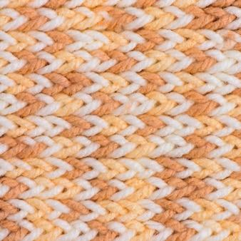 Struttura lavorata a maglia di lana bianca con texture