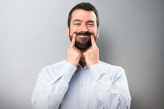 Uomo bello con la barba con febbre su sfondo testurizzato