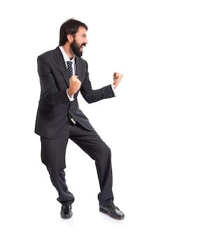 Uomo d'affari fortunato isolato su sfondo bianco