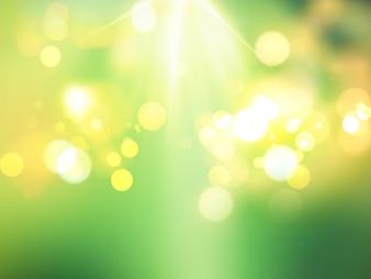 Verde bokeh luci di sfondo con i raggi del sole