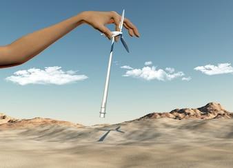 3D render de uma mão feminina colocando turbinas eólicas em um deserto