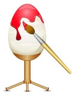 Pintando um ovo de Páscoa com uma escova