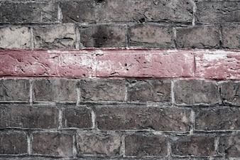 A linha vermelha na parede