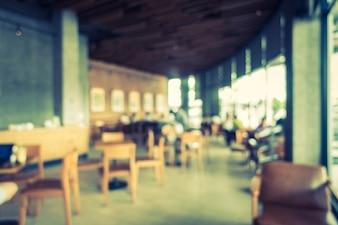 Abstrato borrão e cafetaria defocused interior do café