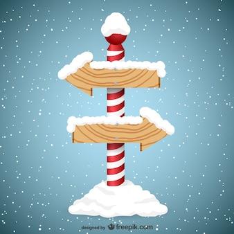 Sinais da seta de madeira com neve