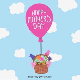 As mães Cartão do dia com a cesta e balão