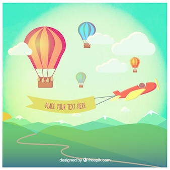 Balões de ar quente e um avião com uma bandeira