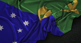Bandeira da Ilha de Natal enrugada no fundo escuro 3D Render