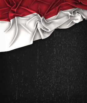 Bandeira de Indonésia Vintage em um Quadro preto de Grunge com espaço para texto