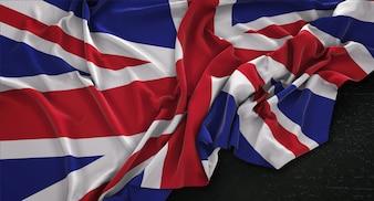 Bandeira do Reino Unido enrugada no fundo escuro 3D Render