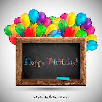 Blackboard com balões para o aniversário