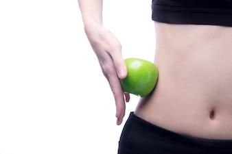 Bom corpo saudável e curva cintura e maçã verde