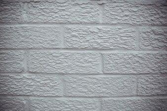 Branca pintou o fundo da parede de pedra