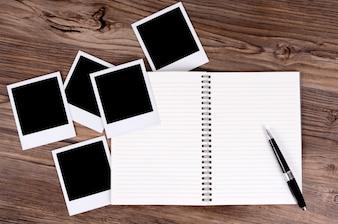 Caderno em branco com algumas fotos