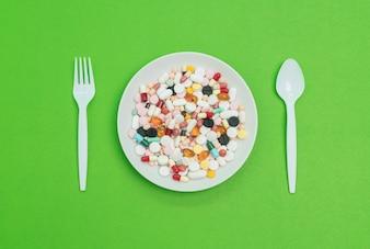 Cápsulas e pílulas coloridas