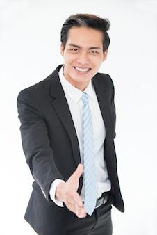 Cheerful, jovem asiático, saudação, parceiro de negócios