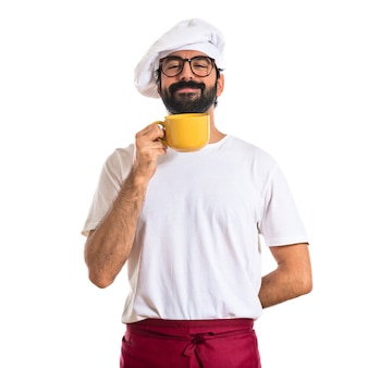 Chef segurando uma xícara de café