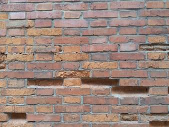 Close-up da parede de tijolo quebrado