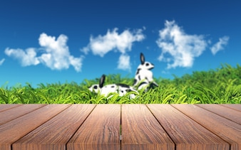 Coelhos adoráveis na paisagem com uma mesa de madeira