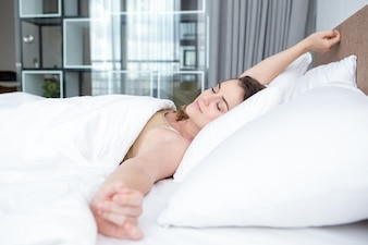 Content Beautiful Woman Waking up in Bed