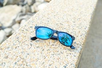 Óculos de sol perto
