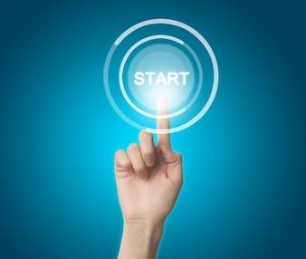"""Dedo que pressiona um círculo com a palavra """"start"""""""