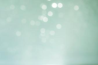 Desenfoque do fundo abstrato das luzes azuis. Foto natural bokeh