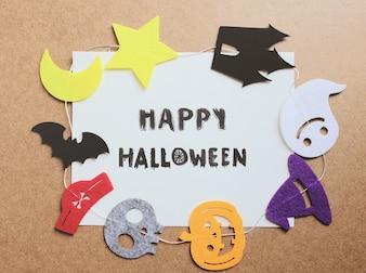 Dia das bruxas feliz escrito no papel com ornamento de Halloween para quadro