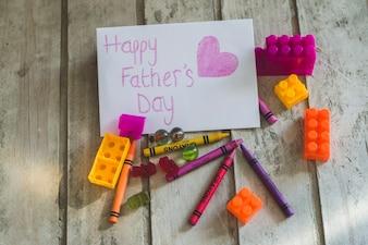 Escrevendo do dia de pai com brinquedos