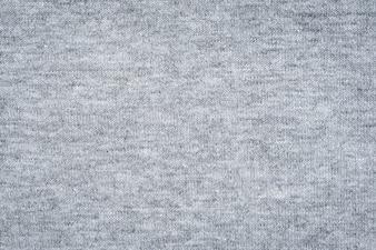 Feche a textura de tecido cinza e fundo com espaço.