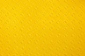 Feche acima de fundo e textura de metal amarelo